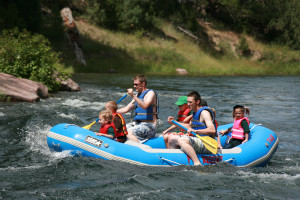 Family rafting at Flaming Gorge Lodge.