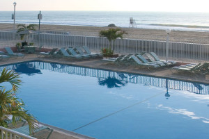 Outdoor pool with beach view at Quality Inn Boardwalk Ocean City.