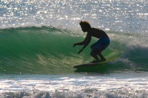 Surfing near Black Dolphin Inn.