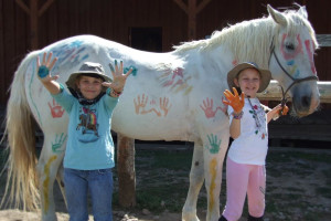 Kids painting horse at Goosewing Ranch.