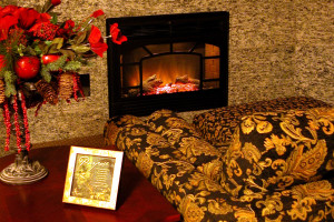 Relax by the fireplace at Rushmore Express Inn & Family Suites.