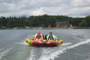 Tubing on lake at Cozy Bay Resort.