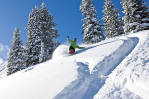 Snowboarding down Vail Mountain at Vail's Mountain Haus.