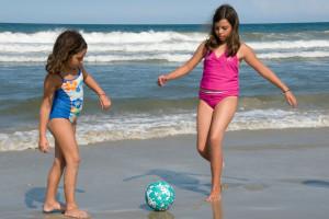 Kids kicking ball on beach at The Sea Ranch Resort.