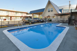 Outdoor Swimming Pool at University Inn & Suites