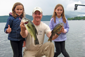 Family fishing at Northern Lake George Resort.