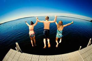 Kids jumping in lake at Grand View Lodge.