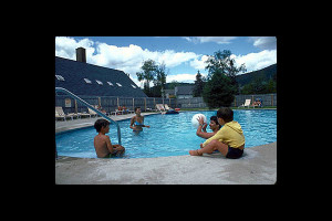 Family swimming at Village Condominium.