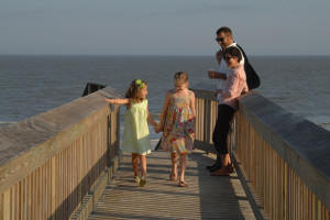 Family on the boardwalk at Hampton Inn & Suites Jekyll Island.