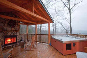 Cabin deck with jacuzzi at Blue Sky Cabin Rentals.