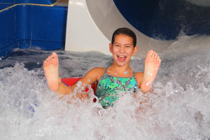 Kid going down water slide at Bavarian Inn of Frankenmuth.