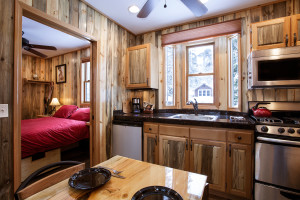 Cabin dining and kitchen at Izaak Walton Inn.