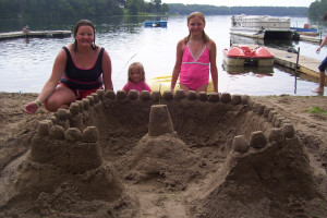 Family on the beach at Shady Hollow Resort.