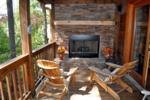 Fireplace deck at Cuddle Up Cabin Rentals.