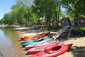 Kayaks on the beach at Dickerson's Lake Florida Resort.