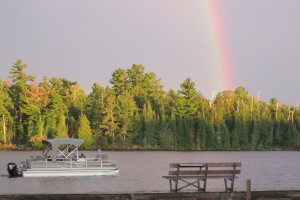 Rainbow over lake at Moosehorn Resort.