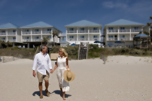 Couple on beach at Ocean Isle Inn.