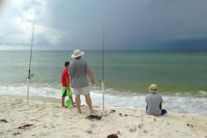Fishing on the beach at Perdido Key Resort Management.