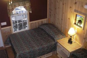 Cabin bed at Darien Lake Resort.