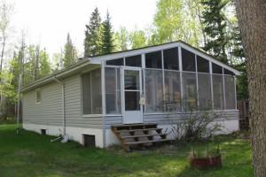 Cabin exterior at The Greenback Hunter.