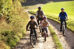 Family biking at Cherry Beach Resort.