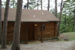 Cabin exterior at Pine Lodge Cabins & Suites.