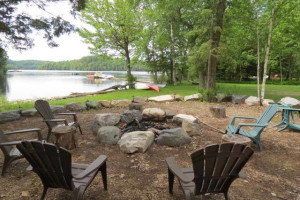 Lakeside Bonfire pit on the shore of Eagle Lake at All-Season Cottage Rentals.