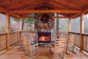 Cabin deck with fireplace at Blue Sky Cabin Rentals.