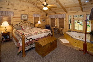 Rental bedroom with whirlpool at Dogwood Cabins LLC.