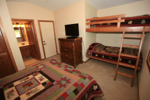 Guest room with bunk beds at East Silent Lake Vacation Homes.
