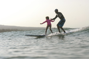 Surfing at Lumeria Maui.