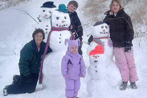 Family building snowmen at Brophy Lake Resort.