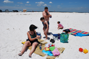Family on the beach at Gulf Pines RV Park.