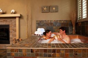 Couple in hot tub at Tigh-Na-Mara Resort.