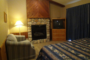 Fireplace bedroom at Kavanaugh's Sylvan Lake Resort.