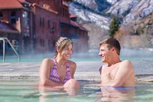 Couple in springs at Glenwood Hot Springs.