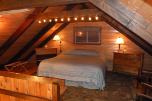 Guest room at Jasmer's Rainier Cabins & Fireplace Rooms.