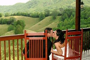 Couple kissing in balcony at Berry Springs Lodge.