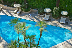 Outdoor pool at Aldrovandi Palace Hotel.