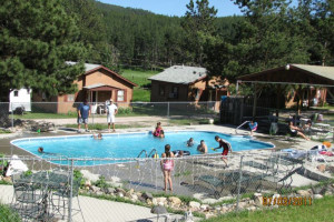 Outdoor pool at Black Hills Cabins & Motel at Quail's Crossing.