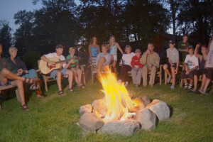 Family around campfire at Brindley's Harbor Resort.