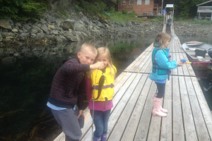 Fishing off the dock at Elfin Cove Resort.