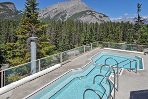 Outdoor pool with a view at Inns of Banff.