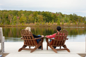 Adirondack chairs overlooking the lake at The Lodge at Woodloch.