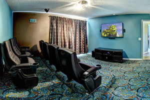 Indoor theater at Tropical Escape Vacation Homes.