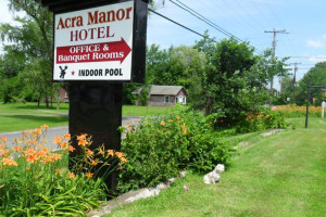 Resort sign at Acra Manor Resort.