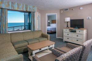 Guest suite living room at The Strand Resort Myrtle Beach.