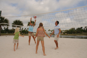 Family playing volleyball at Star Island Resort.