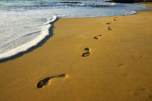 Footprints in the sand at Beach Realty.