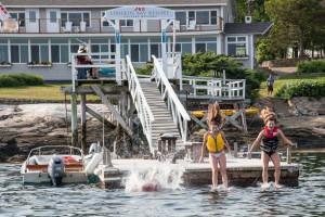 Kids jumping in water at Linekin Bay Resort.